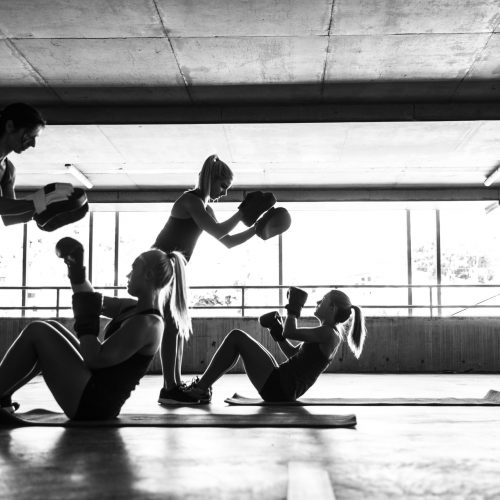 Group of women sport team boxing outdoor inside a multi level parking in Australia.