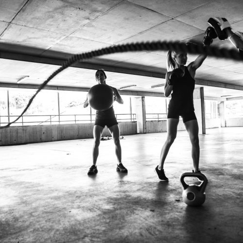 Group of women training on rope and boxing inside an multi level parking in Australia.